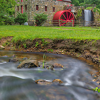 The Old Grist Mill Museum in Sudbury Massachusetts photographed on a beautiful summer day. Wayside Inn Grist Mill Massachusetts photography pictures are available as museum quality photo, canvas, acrylic, wood or metal prints. Wall art prints may be framed and matted to the individual liking and interior design decoration needs:<br />