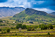 Cottages at the foot of the Maamturk mountains near Maam, Connemara, County Galway, Ireland