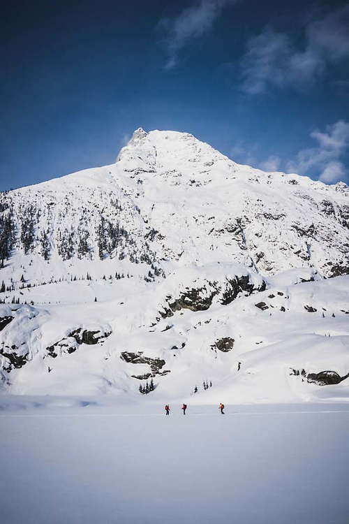 Hank Wissenz, John Connolly, and eric Olson skinning the flats, Howson Range, British Columbia.