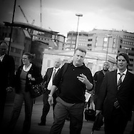 London. UK - employees of the financial district going back home after work, on the london bridge. london