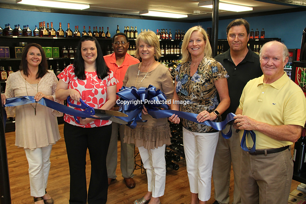 ADAM ARMOUR I BUY AT PHOTOS.ITAWAMBATIMES.COM<br /> EAST FULTON WINE &amp; SPIRITS RIBBON CUTTING - East Fulton Wine &amp; Spirits, located at 703 E. Main Street, Fulton, celebrated its grand reponeing with a ribbon cutting ceremony, Monday. Present were, from left, ICDC executive director Vaunita Martin, owner Hope Edwards, alderman Hayward Wilson, mayor Lynette Weatherford, Fulton Chamber of Commerce executive director Mary Sue Boggs, alderman Barry Childers and Fulton CoC board president Danny Gaither.