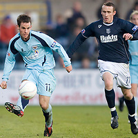 Dundee v St Johnstone....29.11.08<br /> Kevin Moon is closed down by David O'Brien<br /> <br /> Picture by Graeme Hart.<br /> Copyright Perthshire Picture Agency<br /> Tel: 01738 623350  Mobile: 07990 594431