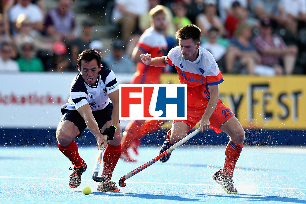 LONDON, ENGLAND - JUNE 17: Wei Adams of Scotland battles for the ball with Thierry Brinkman of the Netherlands during the Hero Hockey World League Semi Final match between Scotland and Netherlands at Lee Valley Hockey and Tennis Centre on June 17, 2017 in London, England.  (Photo by Alex Morton/Getty Images)
