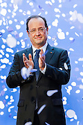 President Francois Hollande in front of the vessel 'Jules Verne' during a ceremony to inaugurate it and celebrate the 35th anniversary of the CMA CGM Group, in Marseille, southern France, on June 4, 2013. The CMA CGM 'Jules Vernes', sailing under the French flag, is the world's largest containership