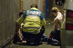 "© Licensed to London News Pictures . 21/10/2012 . Manchester , UK . A male student is tended to by ambulance staff . Students attend a Carnage UK pub crawl at bars in Manchester 's Deansgate Locks with a fancy dress theme of "" Pimps and Hoes "" . The event has been criticised for encouraging binge drinking , sexism and anti-social behaviour . Photo credit : Joel Goodman/LNP"