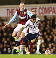 Paulinho of Tottenham Hotspur (right) battles with David Jones of Burnley (left) during the FA Cup match at White Hart Lane, London<br /> Picture by David Horn/Focus Images Ltd +44 7545 970036<br /> 14/01/2015