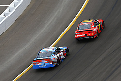 March 10, 2018 - Avondale, Arizona, United States of America - March 10, 2018 - Avondale, Arizona, USA: Kyle Busch (18) and Justin Allgaier (7) battle for position during the DC Solar 200 at ISM Raceway in Avondale, Arizona. (Credit Image: © Chris Owens Asp Inc/ASP via ZUMA Wire)