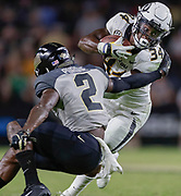 WEST LAFAYETTE, IN - SEPTEMBER 15: Larry Rountree III #34 of the Missouri Tigers runs the ball and is tackled by Elijah Sindelar #2 of the Purdue Boilermakers at Ross-Ade Stadium on September 15, 2018 in West Lafayette, Indiana. (Photo by Michael Hickey/Getty Images) *** Local Caption *** Larry Rountree; Elijah Sindelar NCAA Football - Purdue Boilermakers vs Missouri Tigers at Ross-Ade Stadium in West Lafayette, Indiana. Sports photographer by Michael Hickey