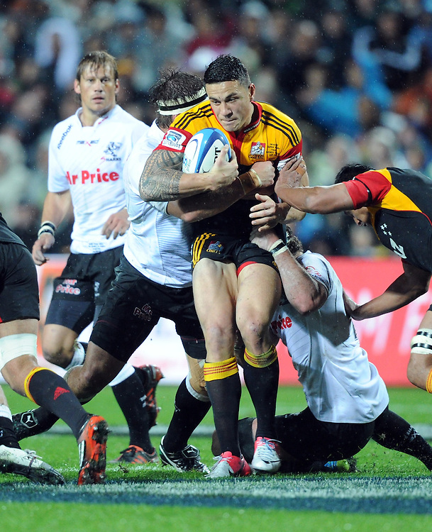 Chiefs Sonny Bill Williams wrapped up by the Sharks defence in the Super 15 Rugby final match, Waikato Stadium, New Zealand, Saturday, August 04, 2012. Credit:SNPA / Ross Setford