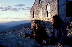 Appalachian Trail. People enjoying summer outside the AMC's Lakes of the Clouds hut near NH's Mt. Monroe.  Lakes of the Clouds, NH