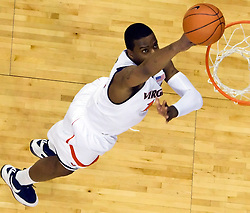 Virginia forward Jamil Tucker (12) finishes a layup against FSU.  The Virginia Cavaliers fell to the Florida State Seminoles 73-62 in NCAA Basketball at the John Paul Jones Arena on the Grounds of the University of Virginia in Charlottesville, VA on January 24, 2009.
