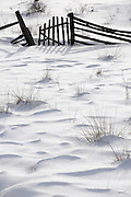 snowy field with wooden fence
