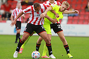 Joshua Cooke and Louis Almond during the Vanarama National League match between Cheltenham Town and Southport at Whaddon Road, Cheltenham, England on 15 August 2015. Photo by Antony Thompson.