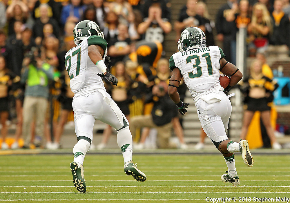 October 6 2013: Michigan State Spartans cornerback Darqueze Dennard (31) runs with the ball after an interception as Michigan State Spartans safety Kurtis Drummond (27) follows during the first quarter of the NCAA football game between the Michigan State Spartans and the Iowa Hawkeyes at Kinnick Stadium in Iowa City, Iowa on October 6, 2013. Michigan State defeated Iowa 26-14.