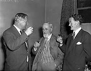 03/09/1958<br /> 09/03/1958<br /> 03 September 1958<br /> Mr Maurice Walsh (author), centre, at David Courtney Ltd. Wine Merchants 21 Molesworth Street, Dublin, enjoying a glass of sherry..