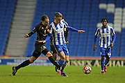Brighton & Hove Albion striker Solly March (20) and Milton Keynes Dons midfielder Edward Upson (6) during the The FA Cup match between Brighton and Hove Albion and Milton Keynes Dons at the American Express Community Stadium, Brighton and Hove, England on 7 January 2017.