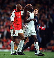 Patrick Vieira is consoled by Thierry Henry after he is sent off by referee Graham Poll. Arsenal 2:0 Liverpool, F.A.Carling Premiership, 21/8/2000. Credit : Colorsport / Andrew Cowie.