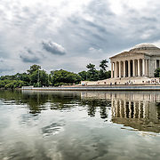 The Jefferson Memorial seen from water level in the Tidal Basin on an overcast day.
