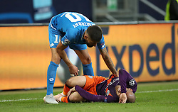 Hoffenheim's Kerem Demirbay tends to Manchester City's David Silva lies injured on the pitch