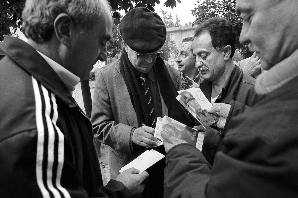 Meeting for the anniversary of the march on Rome. Romano Mussolini the last surviving son of Benito Mussolini sign autographs for his fans..