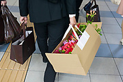 businessman carrying a box with flowers Japan Tokyo