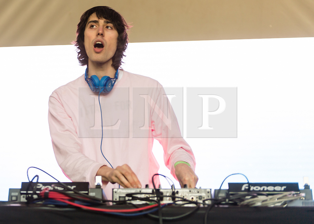"""© Licensed to London News Pictures. 06/06/2015. London, UK.   A.G.Cook performing live at Field Day Festival Saturday Day 1.   A. G. Cook is a British music producer and head of record label PC Music. Cook's dense, chaotic arrangements are distorted versions of mainstream pop music. He was named #12 in the Dazed 100 for """"redefining style and youth culture in 2015 and beyond"""".  Photo credit : Richard Isaac/LNP"""