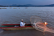 Indigenous Purépecha butterfly fisherman on Lake Patzcuaro at twilight near Janitzio Island, Michoacan, Mexico. Indigenous Purépecha butterfly fisherman on Lake Patzcuaro at twilight near Janitzio Island, Michoacan, Mexico.