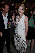 ROSAMUND PIKE, 2009 Serpentine Gallery Summer party. Sponsored by Canvas TV. Serpentine Gallery Pavilion designed by Kazuyo Sejima and Ryue Nishizawa of SANAA. Kensington Gdns. London. 9 July 2009.