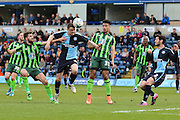 Wycombe Wanderers midfielder Stephen McGinn (4) heads the ball away during the Sky Bet League 2 match between Wycombe Wanderers and AFC Wimbledon at Adams Park, High Wycombe, England on 2 April 2016. Photo by Stuart Butcher.