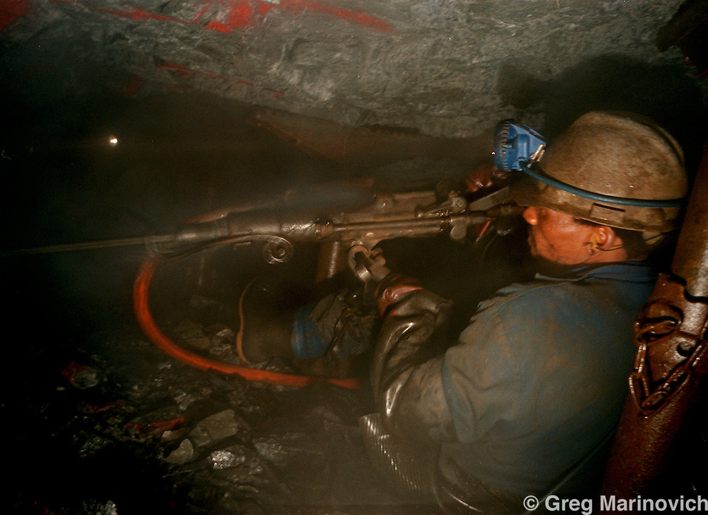 IPMG0390 South Africa, Western Deep, 2000: .A worker drills into the rock around the gold-bearing ore at Anglo Gold's Savuka mine (formerly Western Deep Levels East) the world's deepest mine May 23, 2000, south-west of Johannesburg, South Africa. .Photograph by Greg Marinovich