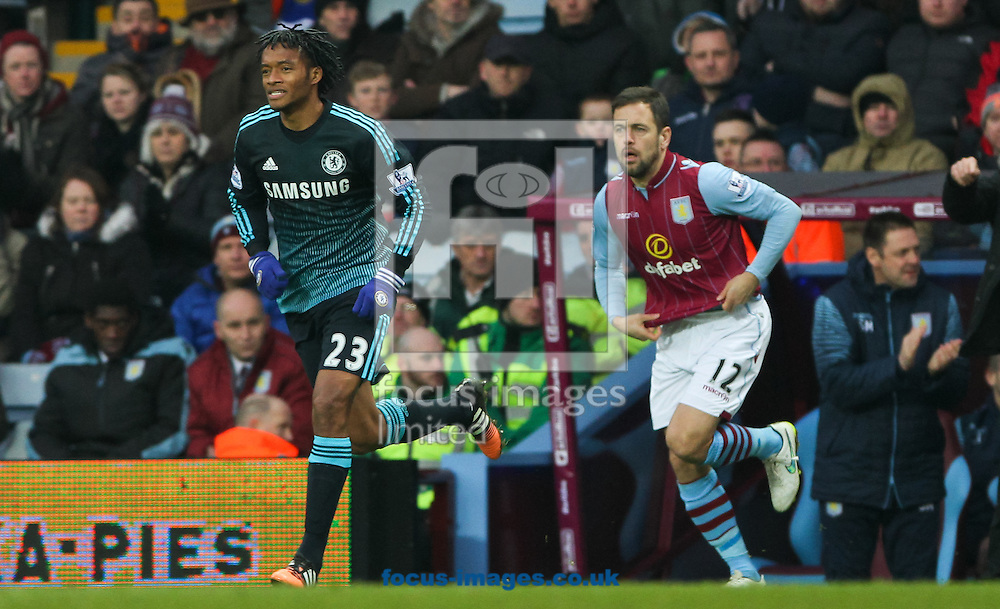 Joe Cole (right) of Aston Villa and Juan Cuadrado (left) of Chelsea during the Barclays Premier League match at Villa Park, Birmingham<br /> Picture by Tom Smith/Focus Images Ltd 07545141164<br /> 07/02/2015