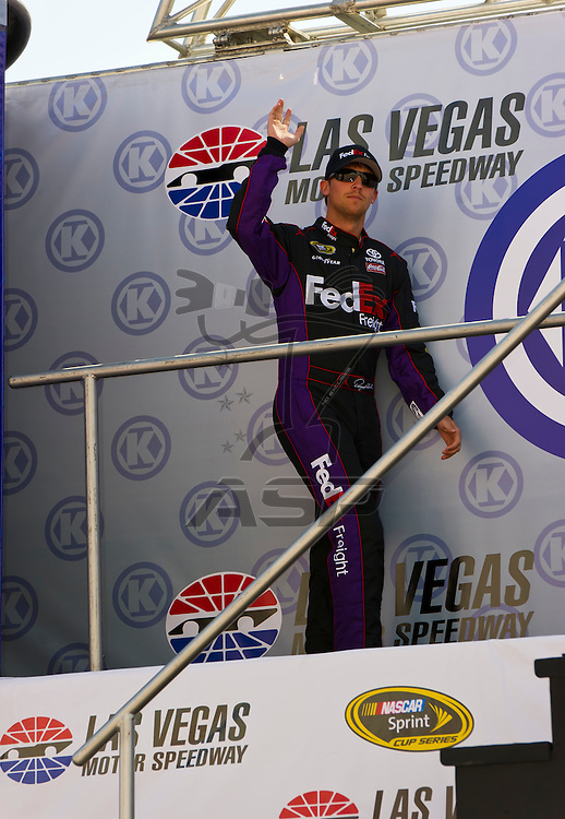 LAS VEGAS, NV - MAR 11, 2012:  Denny Hamlin (11) waves at the fans before the start of the Kobalt Tools 400 race at the Las Vegas Motor Speedway in Las Vegas, NV.