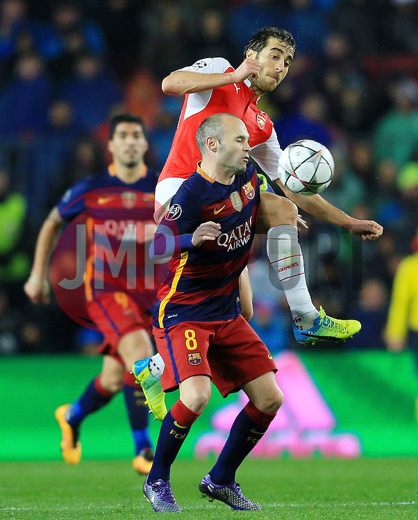Andres Iniesta of Barcelona challenges Mathieu Flamini of Arsenal - Mandatory byline: Matt McNulty/JMP - 16/03/2016 - FOOTBALL - Nou Camp - Barcelona,  - FC Barcelona v Arsenal - Champions League - Round of 16