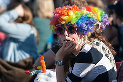 A spectator at the Investec Women's Hockey League Finals Weekend, Sonning Lane, Reading, UK on 13 April 2014. Photo: Simon Parker
