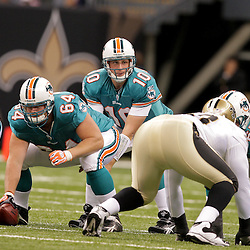 2009 September 03: Miami Dolphins quarterback Chad Pennington (10) under center during a preseason game between the Miami Dolphins and the New Orleans Saints at the Louisiana Superdome in New Orleans, Louisiana.