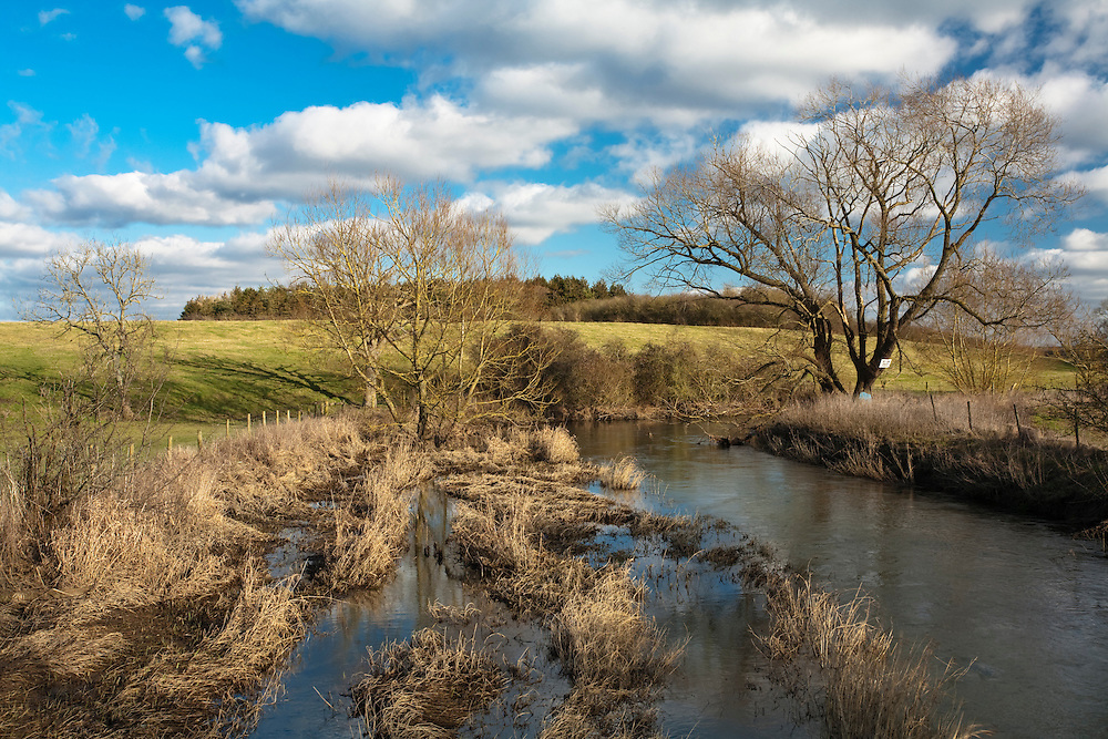Upper reaches of the River Thames from footbridge near Cricklade, Wiltshire, Uk