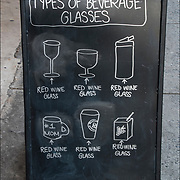 Blackboard humorous  outdoor wine store sign. <br /> <br /> Quote: &quot; Types of Beverage Glasses&quot; Red Wine<br /> <br /> @Taste Wine Co.