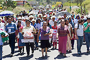 Participants in the 2014 Mexican Network of Mining-Affected Peoples (REMA, for its initials in Spanish) Encounter march through the streets of Tlamanca in support of the local community's struggle against JDC Minerals, a Chinese gold mining firm. Hundreds of people from mining-affected communities throughout Mexico gathered for three days to exchange experiences, renew alliances and discuss strategies. Tlamanca, Zautla, Puebla, México. March 16, 2014.