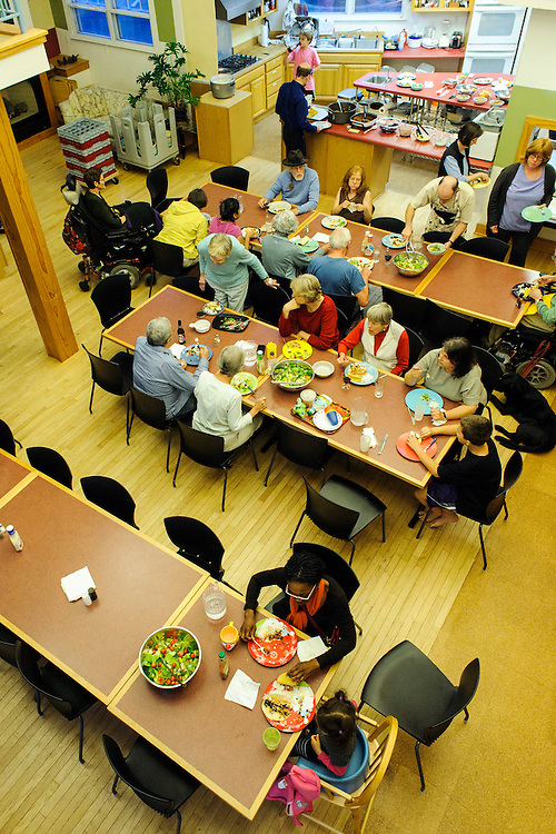 "photo by Matt Roth..Takoma Village Cohousing residents, including chat during the weekly ""Soup n' Simple"" dinner held in the complex's Common House, Monday, September 24, 2012. Tacos are on the menu."
