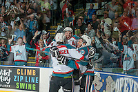 KELOWNA, CANADA - MAY 11: Rourke Chartier #14, Lucas Johansen #7 and Gage Quinney #20 of Kelowna Rockets celebrate the second goal of the first period against the Brandon Wheat Kings on May 11, 2015 during game 3 of the WHL final series at Prospera Place in Kelowna, British Columbia, Canada.  (Photo by Marissa Baecker/Shoot the Breeze)  *** Local Caption *** Rourke Chartier; Lucas Johansen; Gage Quinney;