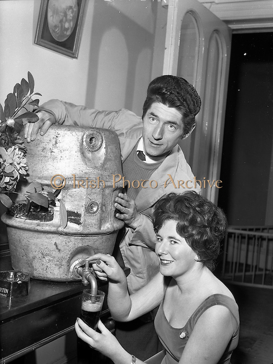"20/09/1960<br /> 09/20/1960<br /> 20 September 1960<br /> Actors Ann O'Dwyer and Charles Roberts. Ann O'Dwyer who starred in Late Night Review at the Pike Theatre and Husband Charles Roberts, who played  the lead in ""The Scatterin"" draw a Guinness  at their home in Monkstown, Dublin to celebrate the success of both shows."