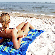 A girl sunbathing on the beach along the Courtney Campbell Causeway in Tampa, Florida. (AP Photo/Alex Menendez) Florida scenic highway photos from the State of Florida. Florida scenic images of the Sunshine State.