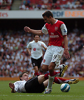 Photo: Tony Oudot. <br /> Arsenal v Fulham. Barclays Premiership. 12/08/2007. <br /> Robin Van Persie of Arsenal is tackled by Chris Baird of Fulham