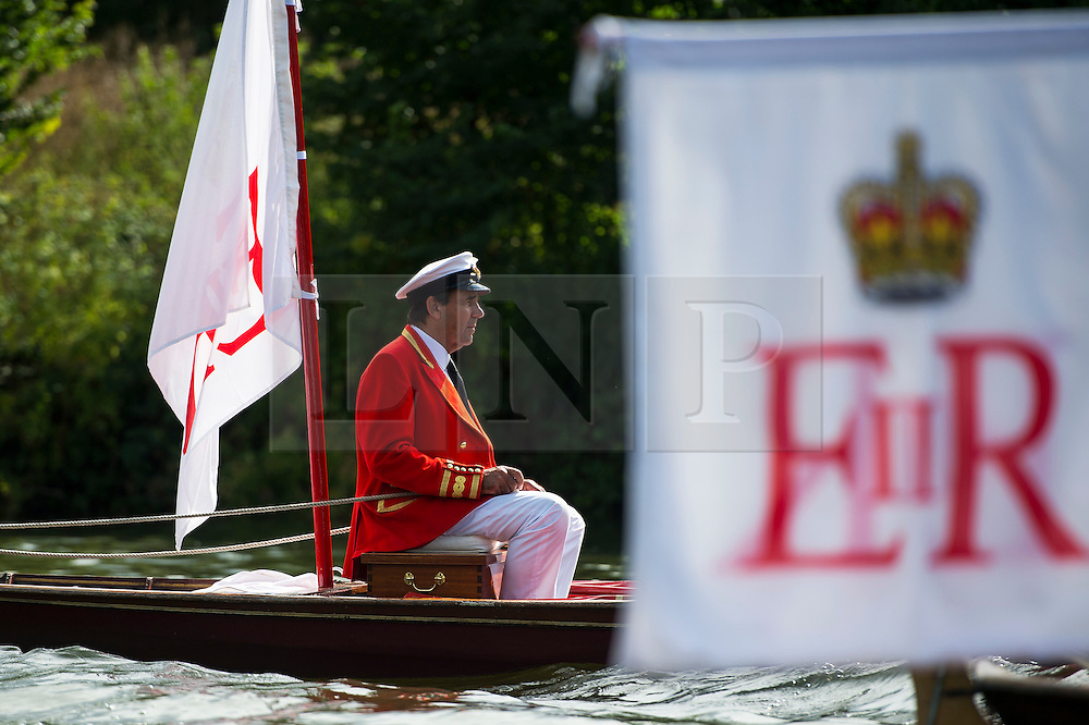 © Licensed to London News Pictures. 20/07/2015. David Barber, The Queen's Swan Marker. Swan Upping takes place on the River Thames near Windsor, Berkshire, UK. The annual event dates from medieval times, when The Crown claimed ownership of all mute swans which were considered an important food source for banquets and feasts. Today, the cygnets are weighed and measured to obtain estimates of growth rates and the birds are examined for any sign of injury, commonly caused by fishing hook and line. The cygnets are ringed with individual identification numbers by The Queen's Swan Warden, whose role is scientific and non-ceremonial. The Queen's Swan Marker produces an annual report after Swan Upping detailing the number of swans, broods and cygnets counted during the week. Photo credit: Ben Cawthra/LNP