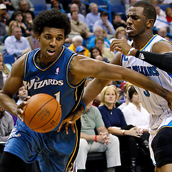 February 1, 2011; New Orleans, LA, USA; Washington Wizards shooting guard Nick Young (1) drives past New Orleans Hornets point guard Chris Paul (3) during the third quarter at the New Orleans Arena. The Hornets defeated the Wizards 97-89.  Mandatory Credit: Derick E. Hingle