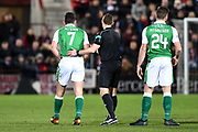 Referee Steve McLean looks after hot transfer topic John McGinn during the Ladbrokes Scottish Premiership match between Heart of Midlothian and Hibernian at Tynecastle Stadium, Gorgie, Scotland on 27 December 2017. Photo by Kevin Murray.