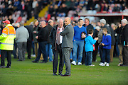 Stand Evacuated - Exeter City manager Paul Tisdale on the pitch with fans from the Stagecoach Stand after smoke was spotted which resulted in the stand being evacuated during the Sky Bet League 2 match between Exeter City and Carlisle United at St James' Park, Exeter, England on 12 March 2016. Photo by Graham Hunt.