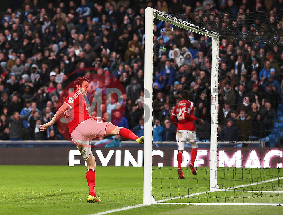 Middlesbrough's Lee Tomlin kicks the post in frustration after missing an open goal - Photo mandatory by-line: Matt McNulty/JMP - Mobile: 07966 386802 - 24/01/2015 - SPORT - Football - Manchester - Etihad Stadium - Manchester City v Middlesbrough - FA Cup Fourth Round