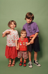 Portrait of group of children standing together smiling,