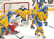 The Lake Superior State Lakers players (left to right) Chad Nehring, goalie Kevin Kapalka, Nick McParland and Will Acton surround the LSSU net during round one of the CCHA playoffs at Taffy Abel Arena.